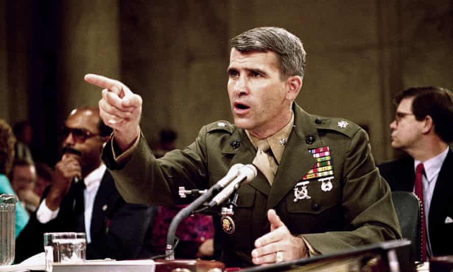 Oliver North, pictured in 1987, is 'a legendary warrior for American freedom', according to Wayne LaPierre, the NRA's executive vice-president.