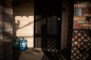 Bottled water on a front porch in Tombstone Territory, an unincorporated working class neighborhood 20 minutes south east of Fresno, California, February 21st, 2020.