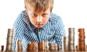 A young boy of 10 counts his money