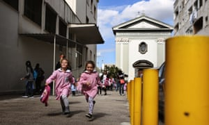 Children run home after school: the elementary school Lenù and Lila would have attended is on the left and the parish church is behind them.