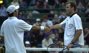 Vince Spadea, left, finally walks to the net a winner after shocking Greg Rusedski at Wimbledon.