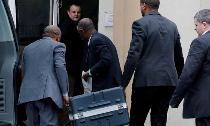 Men unload black boxes from the Ethiopian Airlines Boeing 737 Max jet