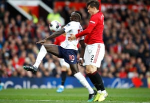 Liverpool's Sadio Mane (left) gets pasts Manchester United's Victor Lindelof to score his side's first goal before the goal is ruled out by VAR for handball.