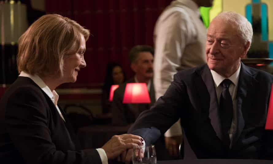 Francesca Annis and Michael Caine as Brian Reader, a career crim with a taste for the finer things in life.
