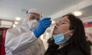A woman is given the antigen test for Covid-19 in Kosice, Slovakia.