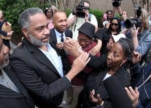 Anthony Ray Hinton is greeted by family outside the Jefferson County jail in Birmingham, Alabama on 3 April 2015.