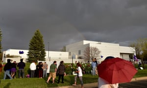 A rainbow emerges over Paisley Park while fans pay their respects to Prince.