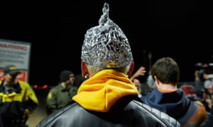 An attendee wears a tinfoil hat as 'alien hunters' gather outside an entrance to Area 51 in Rachel, Nevada, on 20 September.