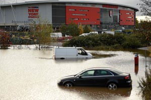 Abandoned cars are pictured in a flooded car park in Rotherham.