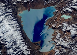 Damxung, Tibet, China Sunlight reflects stunning colours off Nam Co lake in China. In Mongolian, the lake is known as Tenger nuur, which means 'Heavenly Lake'.