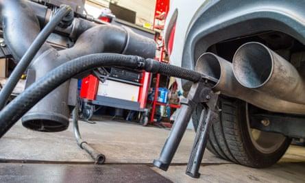 A test device checks exhaust emissions of a VW Golf 2.0 TDI car in Frankfurt/Oder, Germany.