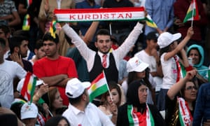 Kurds show their support for the upcoming independence referendum at a rally in Erbil