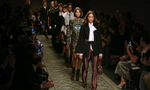 Models present creations by Burberry during the 2017 Spring / Summer catwalk show