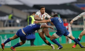 Anthony Watson is tackled by Baptiste Couillard and Jonathan Danty.