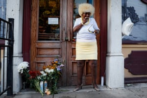 Annette Gibson Strong places candles at a makeshift memorial for the slain and wounded at the scene of a mass shooting in Dayton, Ohio