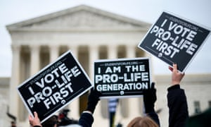 Anti-abortion advocates hold signs as they stand in front of the US supreme court while participating in the 47th annual March For Life in Washington.