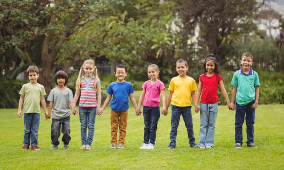 small children posing on grass