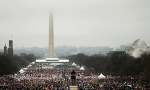 The Washington Monument shrouded in clouds as people pack the National Mall for the Women's March.
