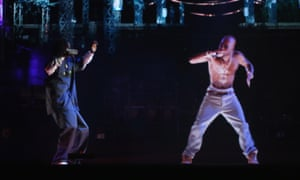 Snoop Dogg (L) and a hologram of Tupac Shakur perform at the 2012 Coachella festival.