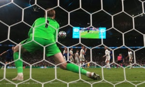 England goalkeeper Jordan Pickford saves a free kick from Italy's Federico Bernardeschi.