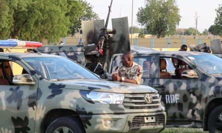 Soldiers block the entrance of the humanitarian group Mercy Corps' office in Maiduguri