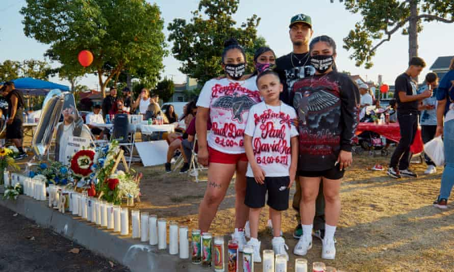 Family members gather at a vigil for Paul Rea on the first anniversary of his death in East Los Angeles on 27 June 2020.