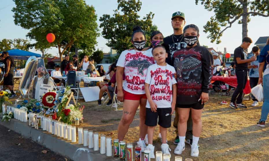 Family members of Paul Rea, who was shot and killed by LA county sheriffs in 2019, gather at a vigil on the one year anniversary of his death.