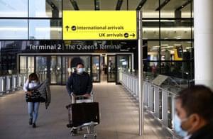 Travellers walk through Terminal 2 at Heathrow airport on 14 February.