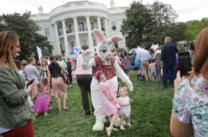 Washington DC, USChildren pose for photographs with one of the costumed Easter Bunny characters during the 139th Easter Egg Roll on the South Lawn of the White House
