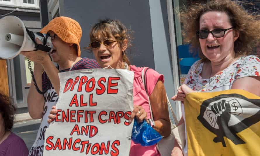 A group protests benefit cuts