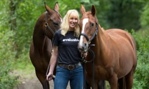 Caroline Casey, pictured with two horses
