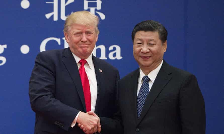Donald Trump with Xi Jinping. The US president has based part of his re-election campaign on his claims of being tough on China but he has maintained a bank account there.