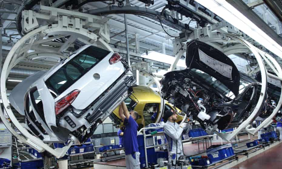 Volkswagen workers on an assembly line in Wolfsburg, Germany