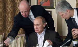 """Vladimir Putin, Yevgeny Prigozhin<br>FILE - In this Friday, Nov. 11, 2011 file photo, businessman Yevgeny Prigozhin, left, serves food to Russian Prime Minister Vladimir Putin, center, during dinner at Prigozhin's restaurant outside Moscow, Russia.  Indicted for alleged U.S. election interference, Prigozhin is a wealthy Russian entrepreneur from St. Petersburg who's been dubbed """"Putin's chef"""" by Russian media, with his catering businesses that have hosted the Kremlin leader's dinners with foreign dignitaries. (AP Photo/Misha Japaridze, Pool, File)"""