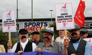 Unite union members dressed as Dickensian workers protest against zero-hours contracts outside Sports Direct.