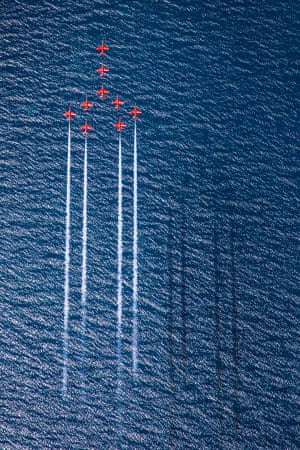 Image of the year, winner. The Red Arrows perform the Concorde formation over the deep blue sea of Greece.