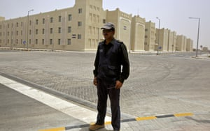 A security guard stands in front of a new facility built to accommodate some 70,000 labourers in Doha, Qatar during a government organised media tour.