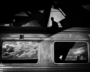 A man sitting on a train