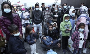 Migrants from the Moria camp on Lesbos arrive at the port of Piraeus, Athens on 4 May. The Greek government has promised to transfer 2,000 asylum seekers to the mainland.