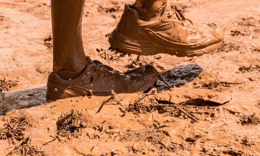 Muddy feet and shoes at the Mud Day race, a 13km obstacle course, in Tel Aviv.