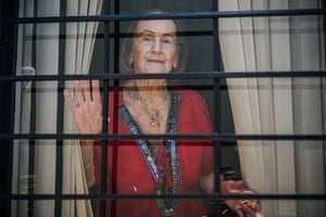 Doña Eida, 98 years old, looks on through the window of her house during social isolation in San Jose, Costa Rica, 24 March.