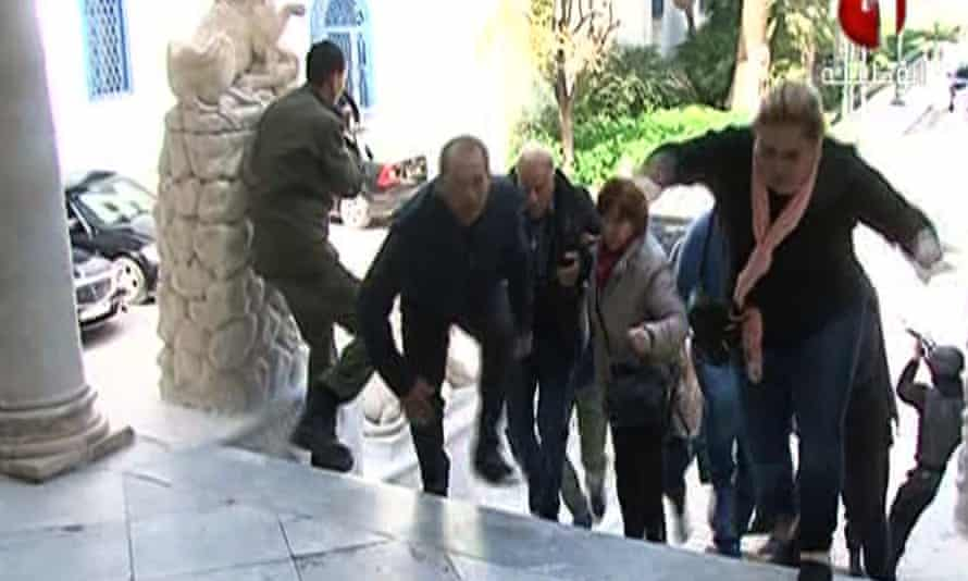 An image grab taken from the Tunisia 1 TV channel shows people escaping from the museum during the attack.