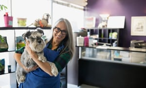 Portrait of smiling dog daycare owner with schnauzer
