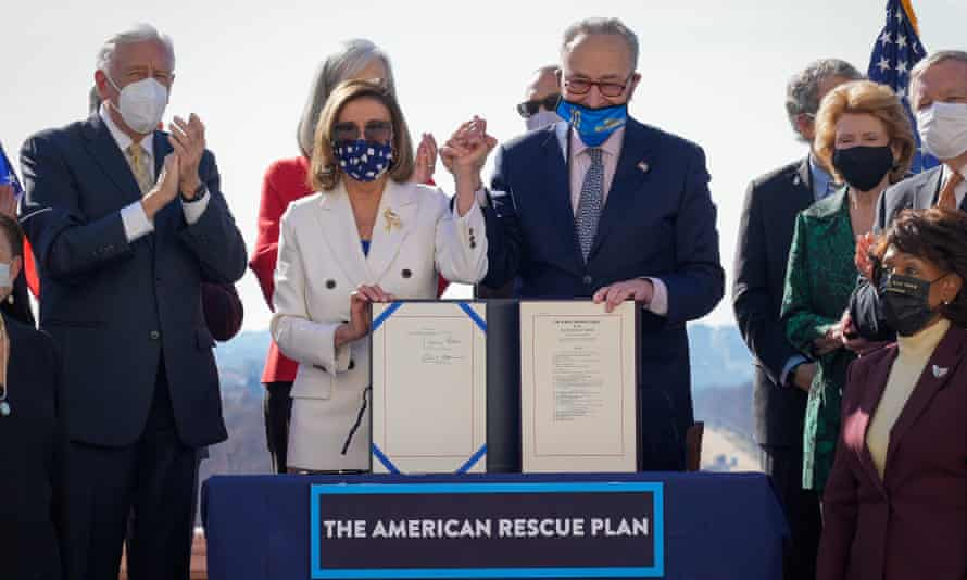 Speaker of the House, Nancy Pelosi, and Senate majority leader, Chuck Schumer, sign the $1.9 trillion Covid-19 relief bill during an enrollment ceremony at the Capitol on Wednesday