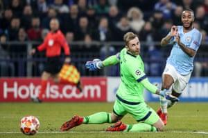 Manchester City's Raheem Sterling slots the ball past Schalke's goalkeeper Ralf Faehrmann.