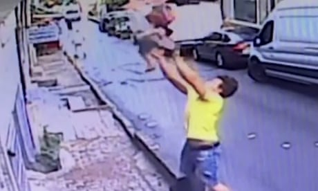 Two-year-old girl is caught after falling from window in Turkey – video