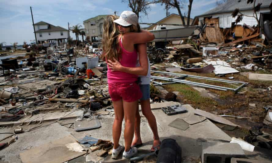 Brenda Roby hugs her neighbor Donna Hanson in the aftermath of Hurricane Ike on 24 September 2008, in Galveston, Texas.