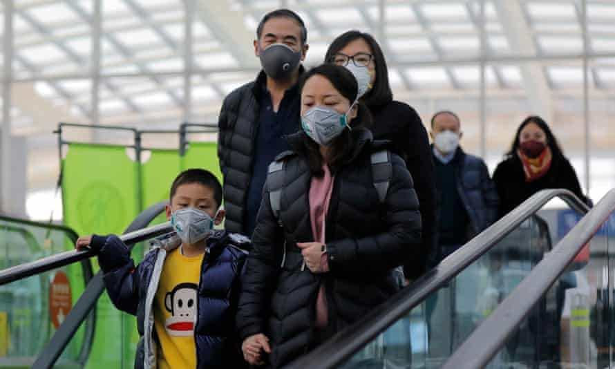 Passengers wearing masks are seen at Beijing airport in China.