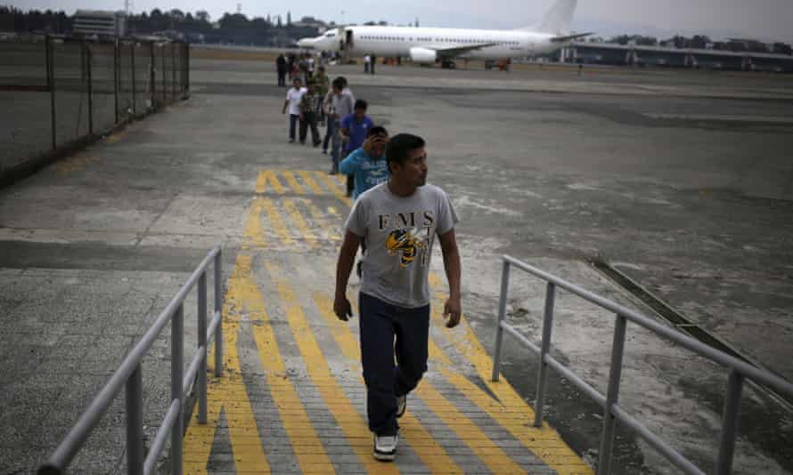 Undocumented migrants from Guatemala, deported from the US, arrive at an air force base in Guatemala City.