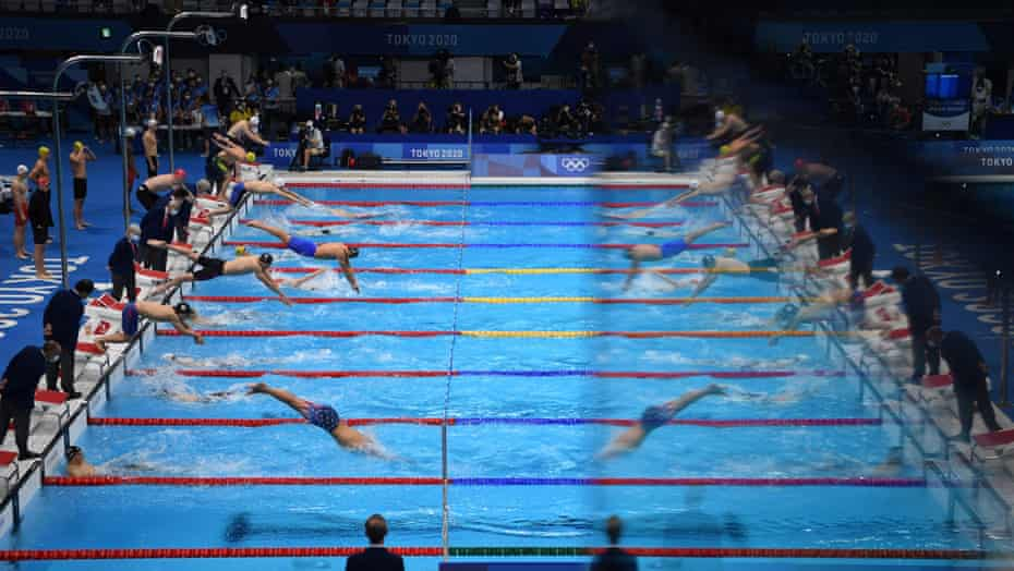 Swimmers compete in the final of the men's 4x100m medley relay.